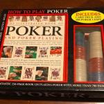 Complete poker set - chips, rule book, deck of cards.