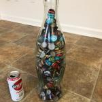 Coke bottle full of bottlecaps