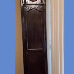 Photo of Tall wood cabinet