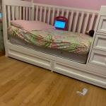 white crib/Trundle bed with shelves and drawers