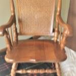 SOLID OAK/CANE ROCKER - EXCELLENT CONDITION - USED ONLY TO STAGE HOMES