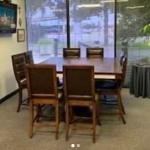 Table and leather top chairs