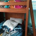Wood bunk bed with drawers and cabinet as well as cubby area