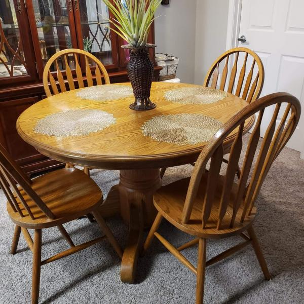 Photo of Oak dining room table and 4 chairs