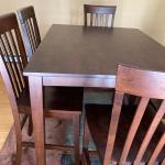 Wood pub table with six chairs