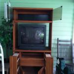 Oak entertainment center with 32 inch tv