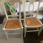 Two white pottery barn chairs