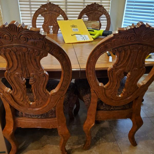 Photo of dining table w 4 upholstered chairs 8 feet