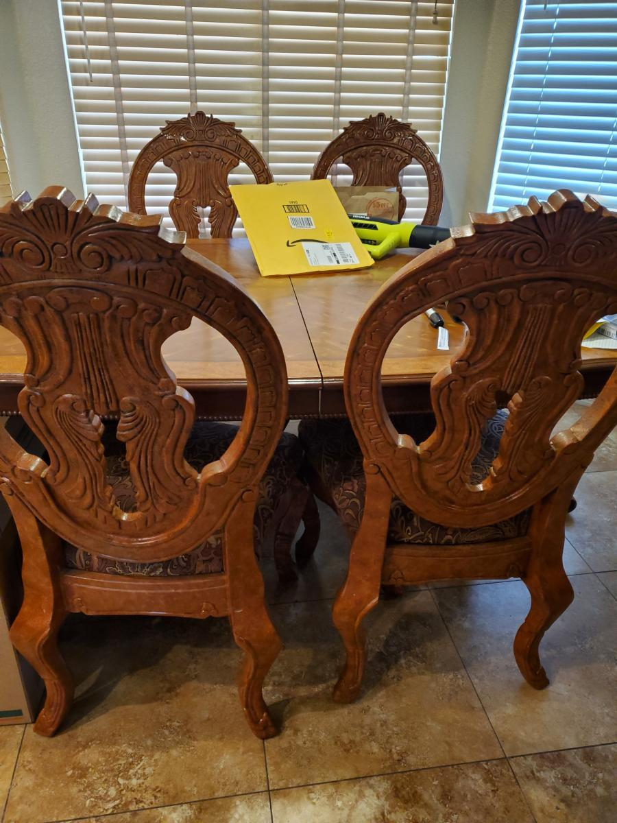 Photo 1 of dining table w 4 upholstered chairs 8 feet