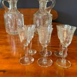 Antique glass decanters with 12 glasses
