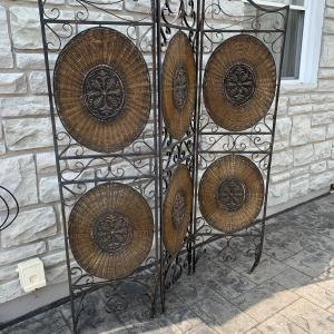 Photo of Ornate Metal and Wicker Screen