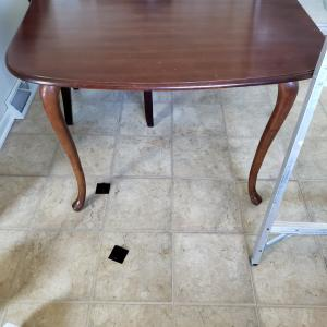 Photo of Table..cherry...with 4 black chairs