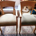 2 Shafer chairs with arms, wooden frames