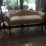 Small camelback love seat