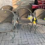 Wanting a new home. 4 Wicker outdoor chairs with patina green.