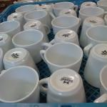 30 Tuxton Cups in Open Commercial Rack.