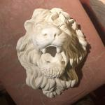 Decorative lion's head wall piece