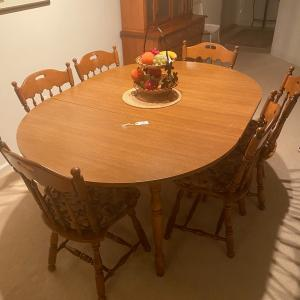 Photo of Dinning room table an chairs