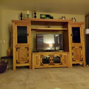 Photo of solid wood entertainment center