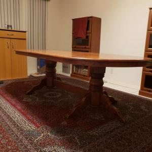 Photo of Wooden Dining table with 8 chairs  in very good condition .