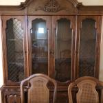 Wood dinning room table with matching hutch