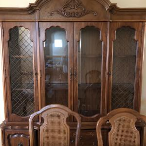 Photo of Wood dinning room table with matching hutch