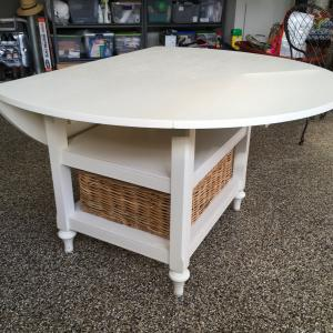 Photo of Solid wood oval drop leaf table & basket