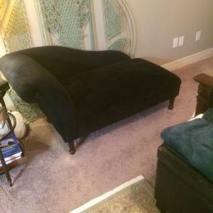Photo of Black velvet chaise lounge