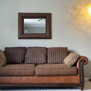 Photo of Brown Leather Heirloom Quality Couch with Pillows
