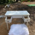 White vanity with faux fir stool