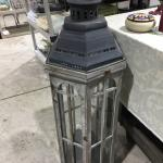 Very tall lantern indoor outdoor. Use with a candle