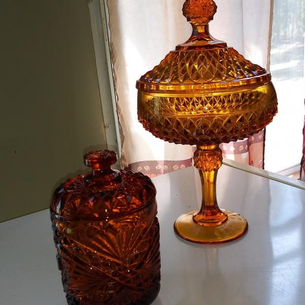 Photo of Carnival glass dishes and a Greek pitcher depicting one of Hercules'12 deeds