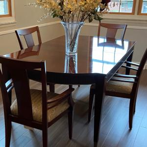 Photo of Dining room table and four chairs