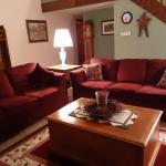 Two burgundy sofas