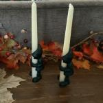 Antique cast-iron gnome candleholders