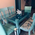 Beachy dining table with glass top and chairs
