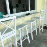 2 white barstools and 2 benches