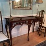 Carved wood console table