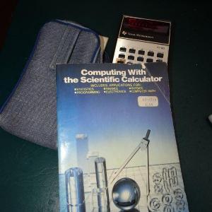 Photo of Texas Instrument Calculator & Book #31