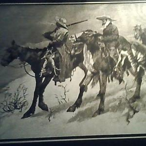 Photo of Remington gold  art work framed in wood