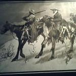 Remington gold  art work framed in wood