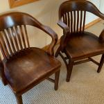 Two antique wooden office chairs