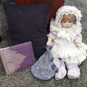 Photo of Porcelain Doll w/ misc. Items
