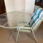 Lot# 217 Round Exterior Wrought Iron Glass Top Table and Chair