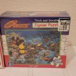 Lot 661: NEW Puzzles Coca Cola 1000 pcs + 200 pc Ocean Scene