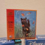 Lot 653: Mickey and Pooh NEW Puzzles 500 pc + 100 pc New Cat Puzzle