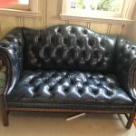 2 TUFTED LEATHER LOVE SEATS