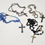 Lot #126  Rosary Lot -  4 vintage rosaries, one Sterling