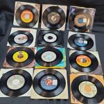 Lot R1: 12 Vinyl 45 rpm with original sleeve most very good pre-owned condition