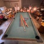 Lot 175. Pool table with sticks (no balls)--$25